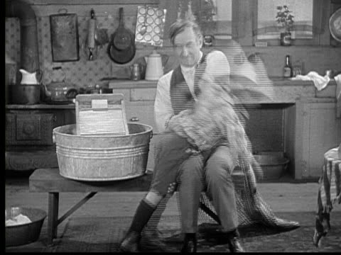 1924 b/w ws man (charles murray) spanking three children one by one, turning them over his knee and pulling up their clothes, then discovers girl wears no panties / usa - mädchen stock-videos und b-roll-filmmaterial