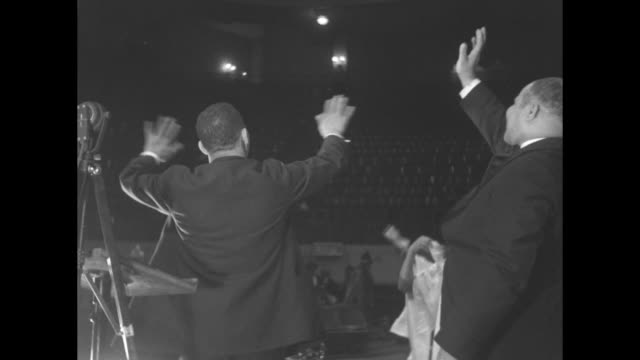 man speaking and clapping choir members jumping in bg probably michaux's wife mary eliza seated nearby michaux encouraging excitement using gestures/... - preacher stock videos and b-roll footage