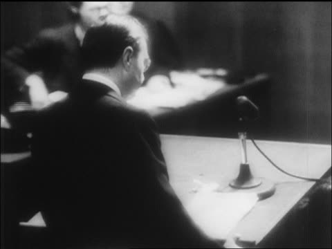 view man speaking into mike at war crimes trials / nuremberg / newsreel - one mature man only stock videos & royalty-free footage