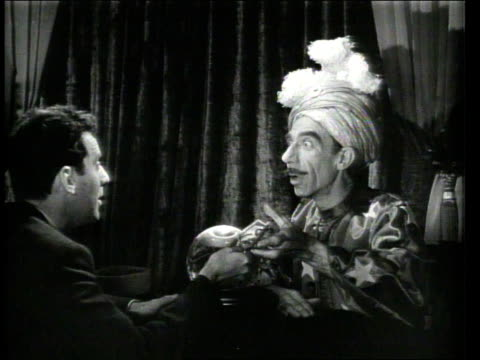 1947 montage man speaking with fortune teller - forecasting stock videos & royalty-free footage