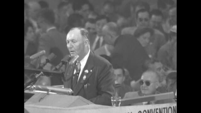 MS man speaks from podium at the 1952 Republican National Convention at the International Amphitheatre / MS large painting of Abraham Lincoln with US...