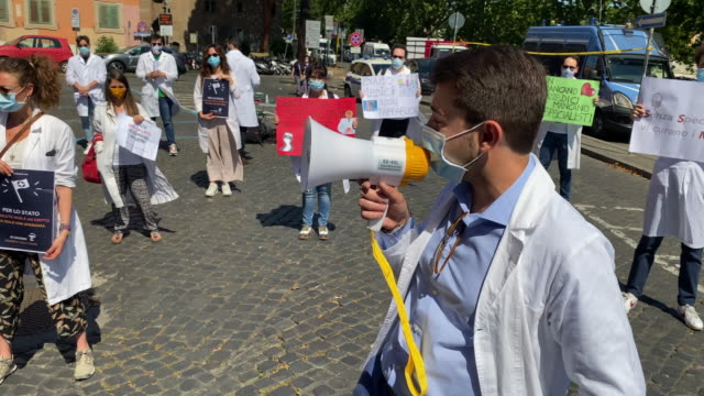man speaks on a loud speaker as young doctors gather together for a demonstration organized by the association for the rights of italian doctors in... - new hire stock videos & royalty-free footage