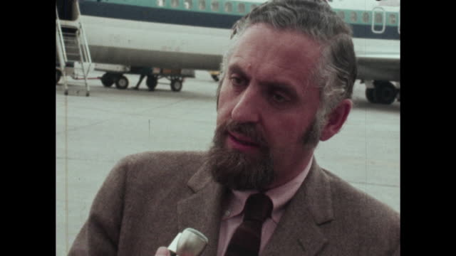 Man speaks to interviewer at Nashville airport regarding birth control morning after pill abortion Eastern Airlines jet in background