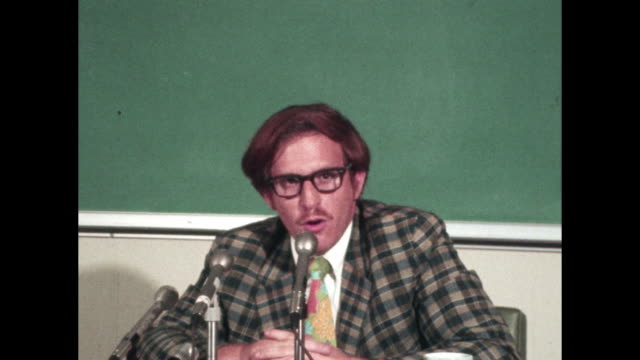 man speaks to reporters wearing plaid blazer - plaid stock videos and b-roll footage