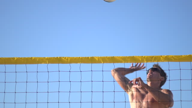 A man spiking a beach volleyball. - Slow Motion - filmed at 240 fps