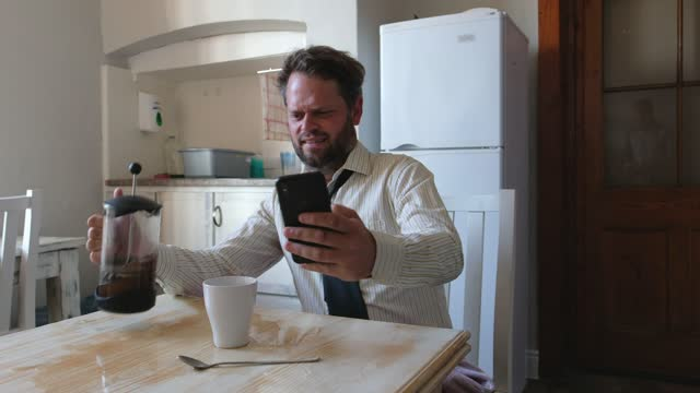 man spills coffee all over the table while at work - blooper film clip stock videos & royalty-free footage