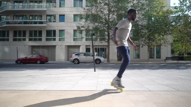 a man spinning round in circles on his inline skates - males stock videos & royalty-free footage