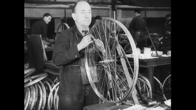 ms man spins and checks bicycle wheel in factory; 1952 - production line worker stock videos & royalty-free footage