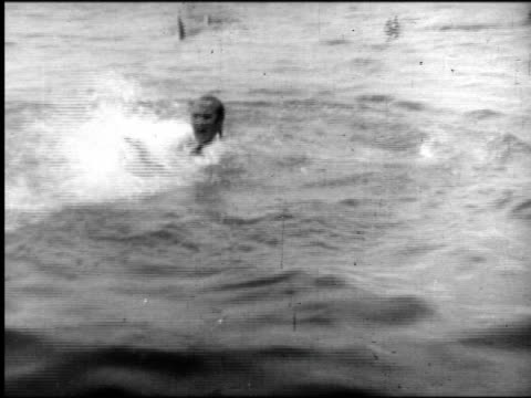b/w man splashing around in water being attacked by sharks - fear stock videos & royalty-free footage
