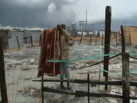 man spreads blanket outdoors - blanket stock videos & royalty-free footage