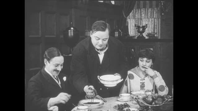 1918 man (fatty arbuckle) squeezes sponge into dinner guests' soup bowls - fatty arbuckle stock videos and b-roll footage