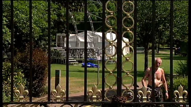 man stabbed after open-air classical concert in southend; england: essex: southend: ext wrought iron gates at entrance to priory park poster on park... - railings stock videos & royalty-free footage
