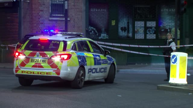 man stabbed by manor house station england london manor house lights** police car police officer and cordons at crime scene police car and discarded... - group of objects stock videos & royalty-free footage