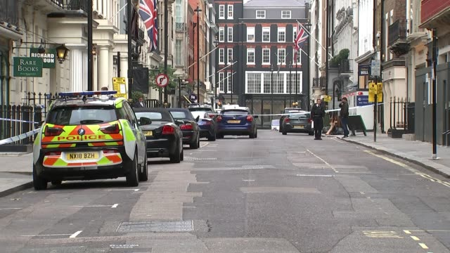 london mayfair dover street ext various shots of police officers police tape cordons and police cars in street - itv london tonight weekend点の映像素材/bロール