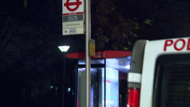 man stabbed in west london; england: london: westbourne green: ext at night various of bus stop where man was found with stab wounds cordoned off by... - itv london lunchtime news stock videos & royalty-free footage