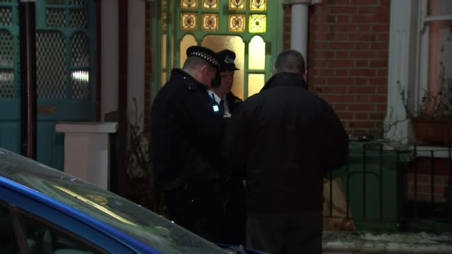 Man stabbed to death in Colindale / woman stabbed to death in Brixton 1542018 Sudbourne Road Various shots of police officers standing outside house...