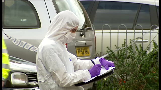 man stabbed to death in edmonton england north london edmonton bedevere road ext forensics officers at work in cordonnedoff area where man in his... - edmonton stock videos and b-roll footage
