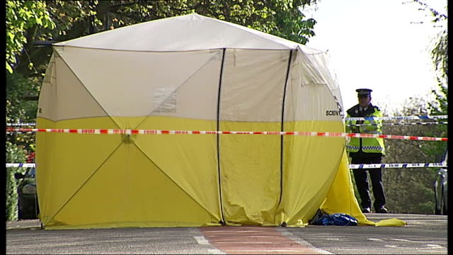 man stabbed to death in highgate; england: london: highgate: ext police cordon tape and marquee at crime scene - highgate stock videos & royalty-free footage