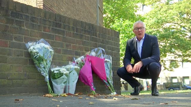 man stabbed to death in kingston uk london kingstonuponthames floral tributes blocks of flats at cambridge gardens estate resident interviews london... - 刺傷事件点の映像素材/bロール