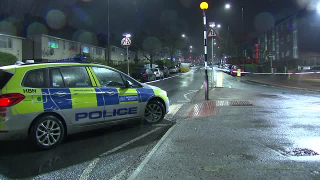 man stabbed to death in neasden; england: london: neasden: ext / night various shots of forensic tent and forensic officers at crime scene police car... - itv london lunchtime news stock videos & royalty-free footage