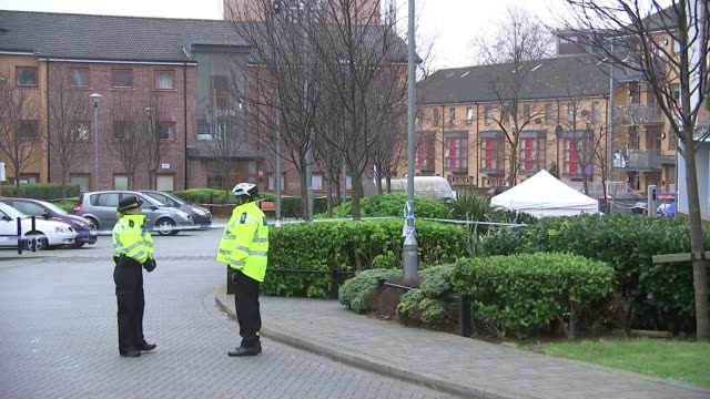 Man stabbed to death in Stoke Newington ENGLAND London Hackney Stoke Newington EXT Sign 'George Downing Estate' Wide shot of forensic tent police...