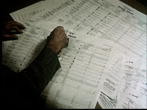 cu, ha, man stamping void voting ballots on desk - voting ballot stock videos and b-roll footage