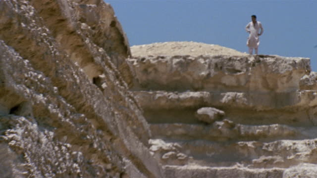 ws zo man standing above stone wall / giza, egypt - stone wall stock videos and b-roll footage