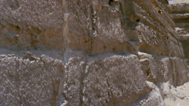 cu zi pan ws man standing above stone wall / giza, egypt - stone wall stock videos and b-roll footage