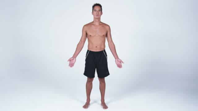 ws man standing against white background / orem, utah, usa - orem utah stock videos & royalty-free footage
