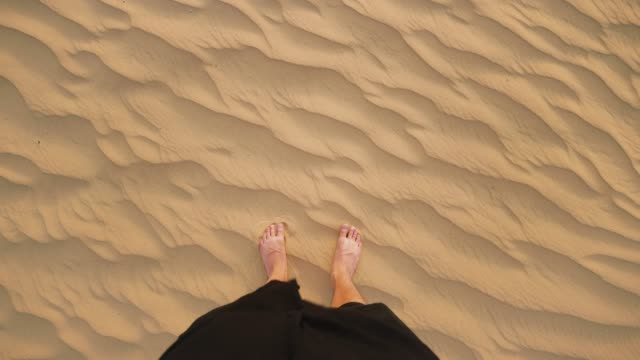 man standing barefoot in the desert pov - high angle view stock videos & royalty-free footage