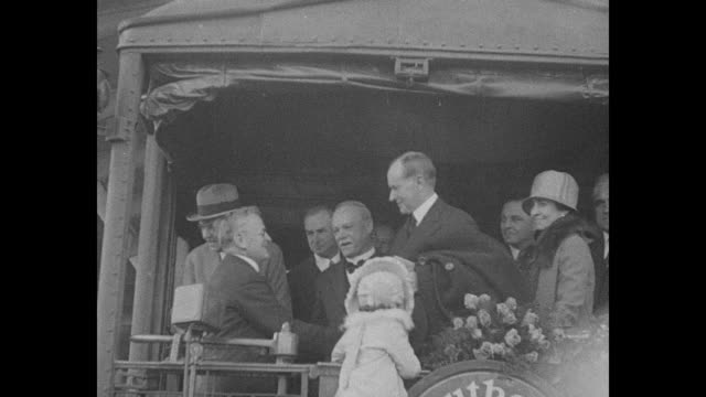 man standing in back of railcar as it moves down tracks men near tracks / calvin coolidge with wife grace and others greets official onto car floral... - coolidge calvin stock videos & royalty-free footage