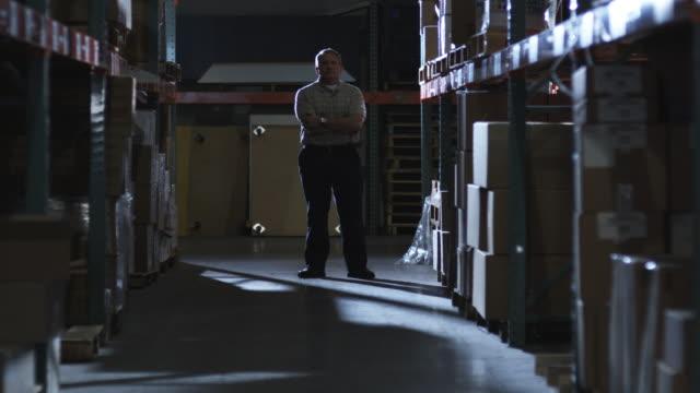 WS Man standing in warehouse corridor, Dallas, Texas, USA