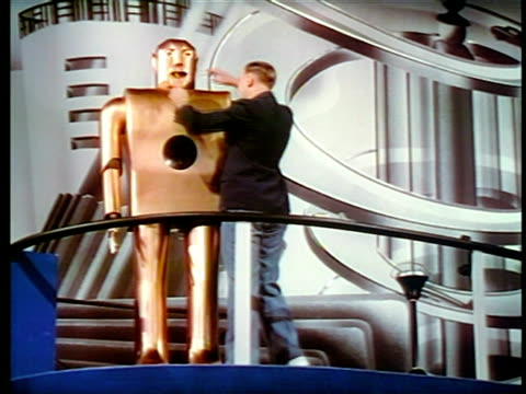 man standing next to robot + giving it cigarette / new york world's fair / industrial - new york world's fair stock videos & royalty-free footage