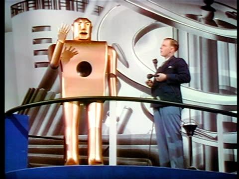 1940 man standing next to robot talking / new york world's fair / industrial - new york world's fair stock videos & royalty-free footage