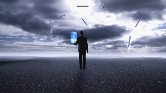 cgi ws man standing on barren plain during thunderstorm, pressing digital control panel, erecting virtual shelter - full length点の映像素材/bロール