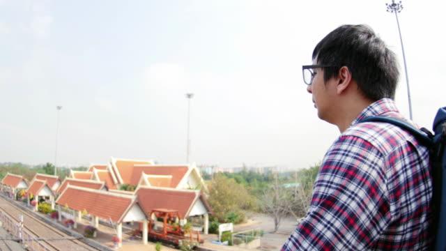 4k : man standing on overpass - musical instrument bridge stock videos & royalty-free footage