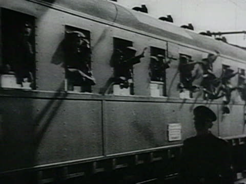 man standing on platform at train station, near nazi officer, salutes and smiles audio / russia - nazism video stock e b–roll
