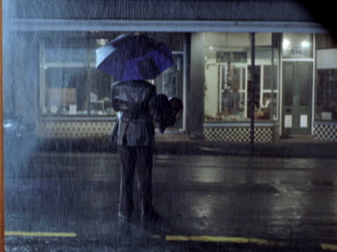 WS Man standing on street in rain, New Zealand