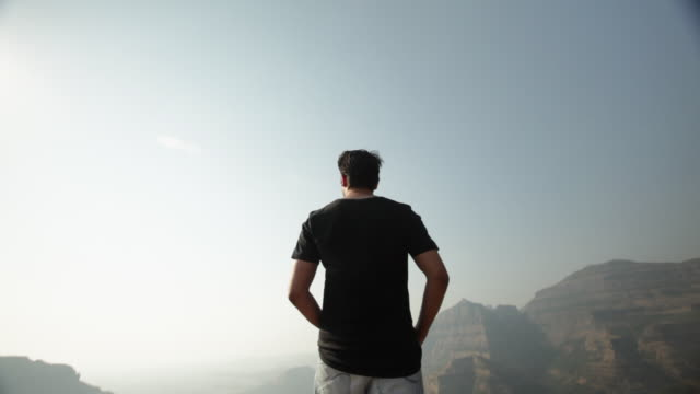 man standing on the cliff of mountain  - standing stock videos & royalty-free footage