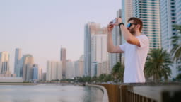 A man standing on the waterfront is a live broadcast from your smartphone