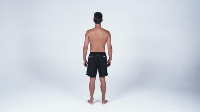 vídeos y material grabado en eventos de stock de ws man standing with hands on hip against white background / orem, utah, usa - orem