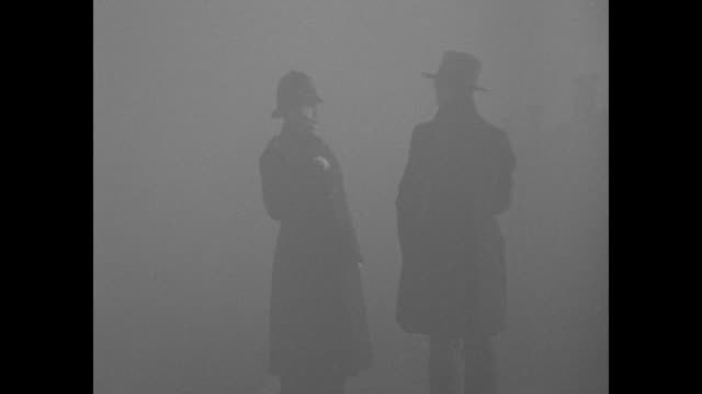 man stands in foggy london sot asks constable to direct him to the police station sot policeman replies that he's been looking for it for 3 hours /... - fog stock videos & royalty-free footage