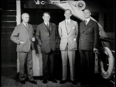 man stands in front of a flying machine / men in suits stand side by side / man speaks about congressional mission to islands / a tall bridge is... - man and machine stock videos & royalty-free footage