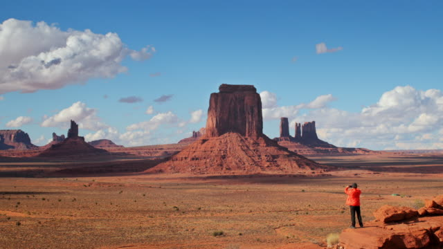 WS A man stands looking out across Monument Valley