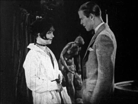 man staring at flapper shaking hands with him / feature - anno 1925 video stock e b–roll