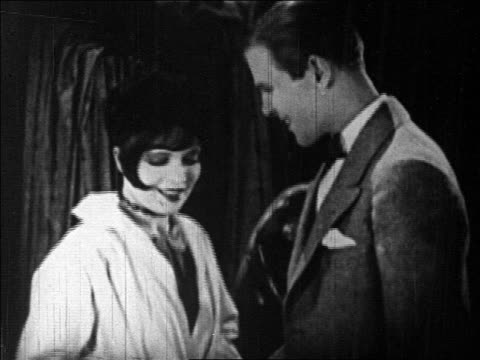b/w 1925 man staring at flapper talking to him / feature - anno 1925 video stock e b–roll