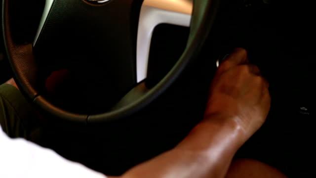 Man starting car engine