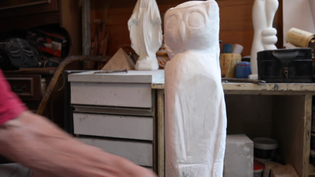 man starting to carve the sculpture - mallet hand tool stock videos and b-roll footage