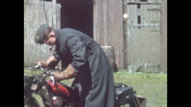 man starting up a motorcycle then riding it in circles next to stone house and barn home movie shot at a house near muckamore co antrim northern... - world war ii stock videos & royalty-free footage