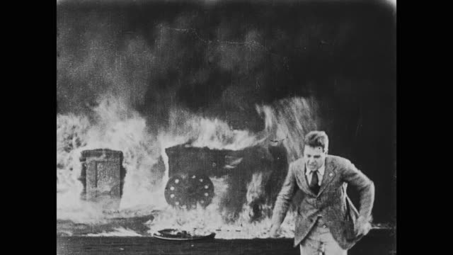 1920 a man starts a large fire in the garage - slapstick stock videos & royalty-free footage
